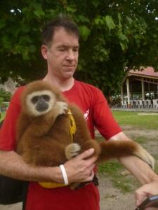 Me cuddling a monkey